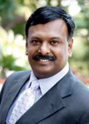 Dr. GIBSON G. VEDAMANI-Trustee & Director
